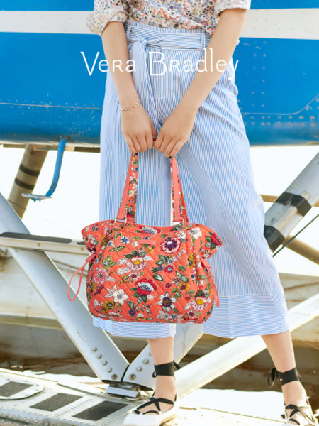 Woman with Vera Bradley purse