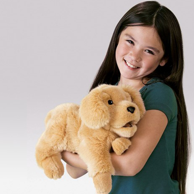 Little girl holding her stuffed dog
