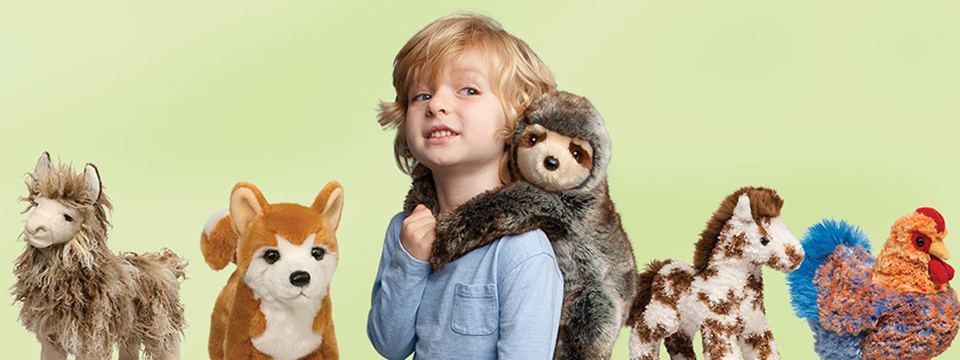 Little boy with his stuffed animals