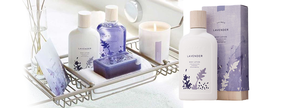 Bathtub with lotions and washes by Thymes with a candle